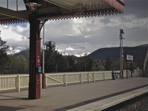 A view from Aviemore Station to snowcapped Cairngorms