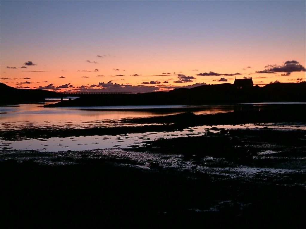 Sunset behind the bridge joining Canna and Sanday
