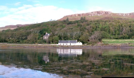 A white single storey house on the shore below Canna House, this was the original laird's house on the shore, now known as The Bothy and tearoom