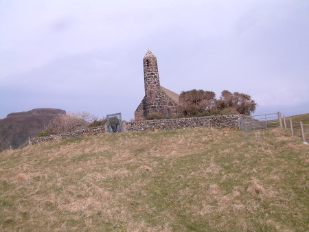 A small stone church with distinctive 'rocket-like' tower
