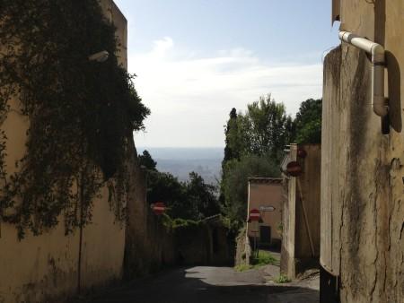 A winding pathway between stone villas